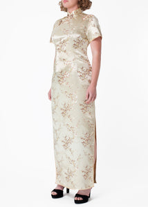 The Cheongsam or Qipao, is a feminine body-hugging dress with distinctive Chinese features of mandarin collar, side splits and hand stitched flower frog fastenings. Manufactured in high quality silk/rayon brocade fabric in a classic gold cherry blossom design - a symbol of female beauty and love.