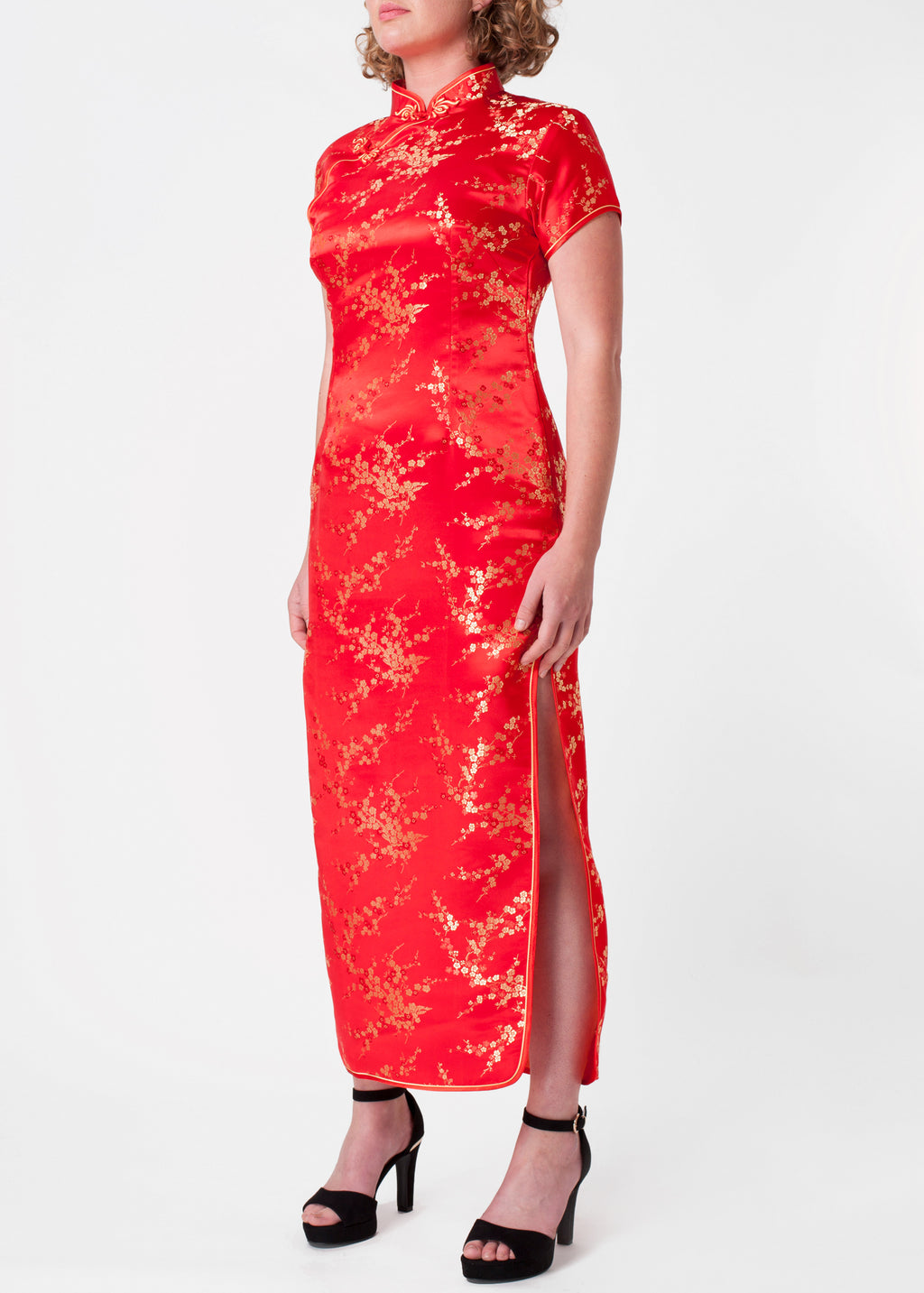 The Cheongsam or Qipao, is a feminine body-hugging Chinese style dress with distinctive features of mandarin collar, side splits and hand stitched flower and knot frog fastenings. Manufactured in authentic high quality silk/rayon brocade in a stunning red with gold cherry blossom design. Quick delivery from UK stock