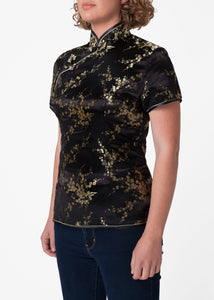 Traditional Chinese blouse in Cheongsam or Qipao style with distinctive Chinese features of mandarin collar, hand stitched flower and knot frog fastenings and side zip. Manufactured in authentic high quality silk/rayon brocade in sophisticated black with gold cherry blossom design - a symbol of female beauty and love.