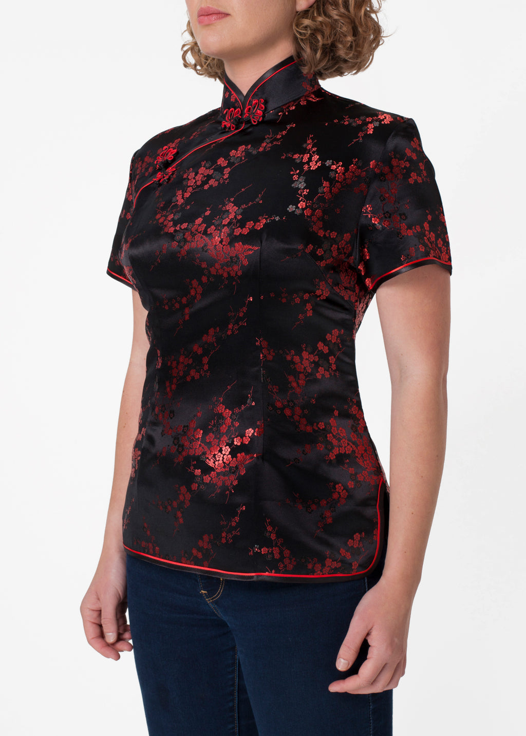 Traditional Chinese blouse in Cheongsam or Qipao style with distinctive Chinese features of mandarin collar, hand stitched flower and knot frog fastenings and side zip. Manufactured in authentic high quality silk/rayon brocade in elegant black with red cherry blossom design - a symbol of female beauty and love.