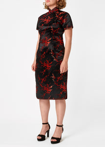 The Cheongsam or Qipao, is a feminine body-hugging dress with distinctive Chinese features of mandarin collar, side splits and hand stitched flower and knot frog fastenings. Manufactured in authentic high quality silk/rayon brocade in black with red cherry blossom design - a symbol of female beauty and love.