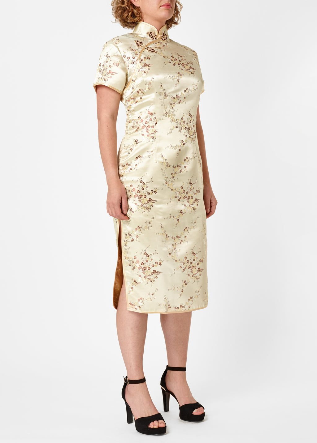The Cheongsam or Qipao, is a feminine body-hugging dress with distinctive Chinese features of mandarin collar, side splits and hand stitched flower and knot frog fastenings. Manufactured in authentic high quality silk/rayon brocade in a classic gold cherry blossom design - a symbol of female beauty and love.