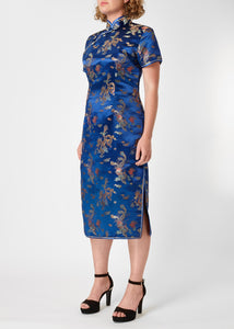 The Cheongsam or Qipao, is a feminine body-hugging dress with distinctive Chinese features of mandarin collar, side splits and hand stitched flower and knot frog fastenings. Manufactured in authentic high quality silk/rayon brocade in a rich blue dragon and phoenix design - a symbol success and prosperity
