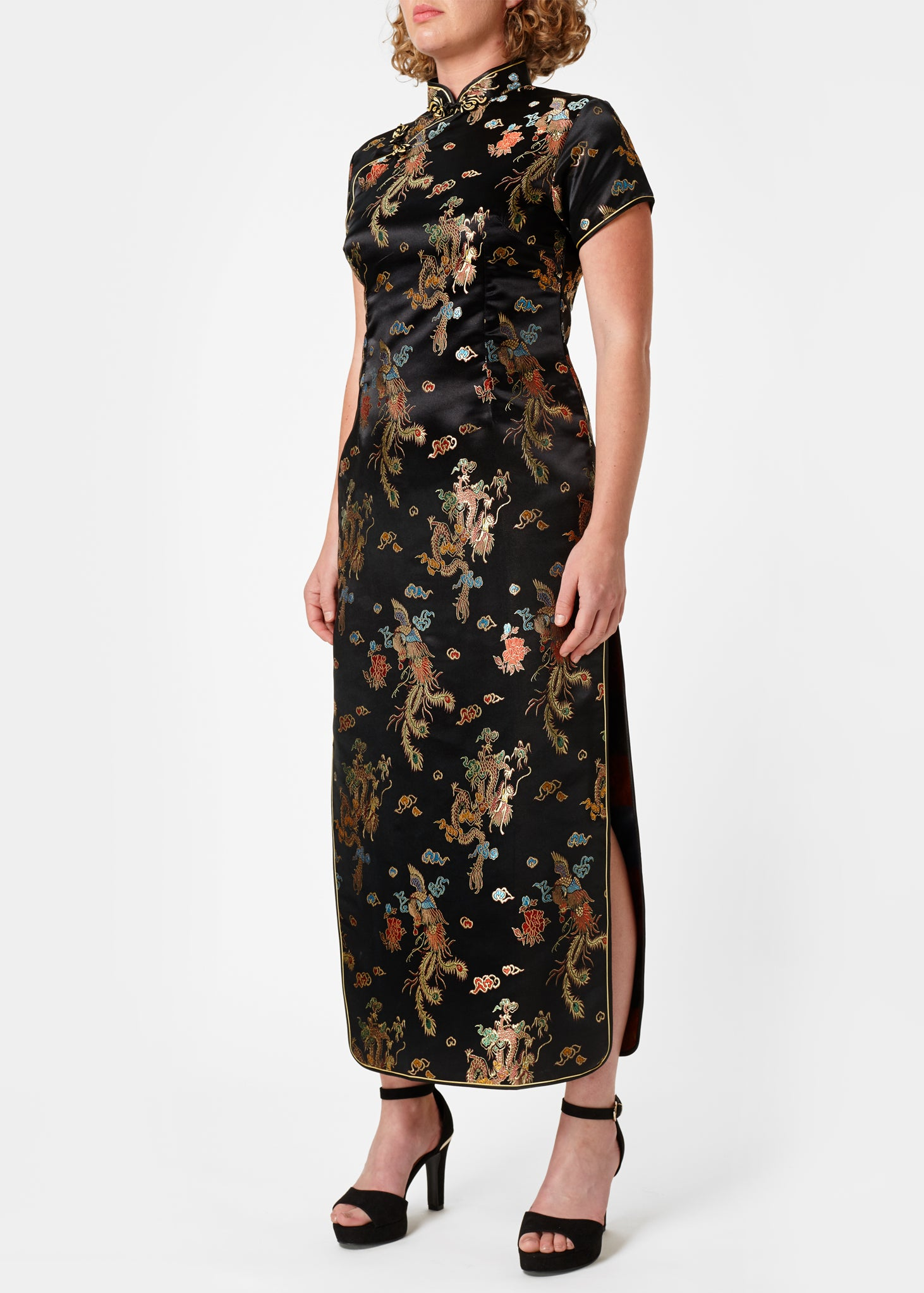 The Cheongsam or Qipao, is a feminine body-hugging dress with distinctive Chinese features of mandarin collar, side splits and hand stitched flower and knot frog fastenings. Manufactured in authentic high quality silk/rayon brocade in a sophisticated black dragon and phoenix design - a symbol of success and prosperity