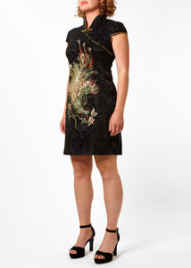 The Cheongsam or Qipao, is a feminine body-hugging dress with distinctive Chinese features of mandarin collar, side splits and hand stitched flower and knot frog fastenings. Manufactured in a sophisticated black stretch cotton jacquard with a sequinned, gold embroidered peacock applique and gold piping.