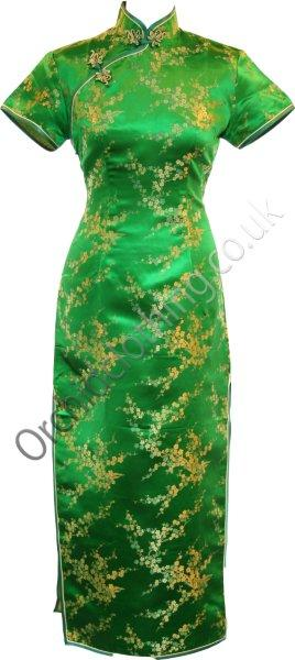 The Cheongsam or Qipao, is a feminine body-hugging dress with distinctive Chinese features of mandarin collar, side splits and hand stitched flower and knot frog fastenings. Manufactured in authentic high quality silk/rayon brocade in a vibrant emerald green cherry blossom design - a symbol of female beauty and love.