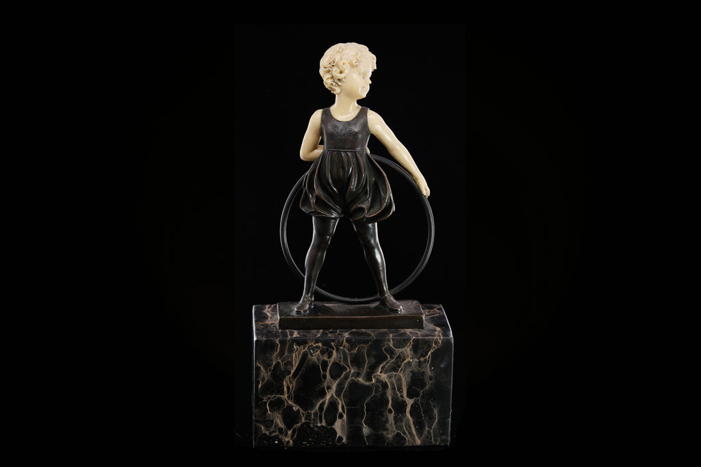 A Bronze Figure of a Young Child with a Hoop.