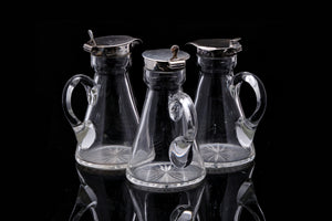 Edwardian Sterling Silver Topped Trio of Sauce Bottles.