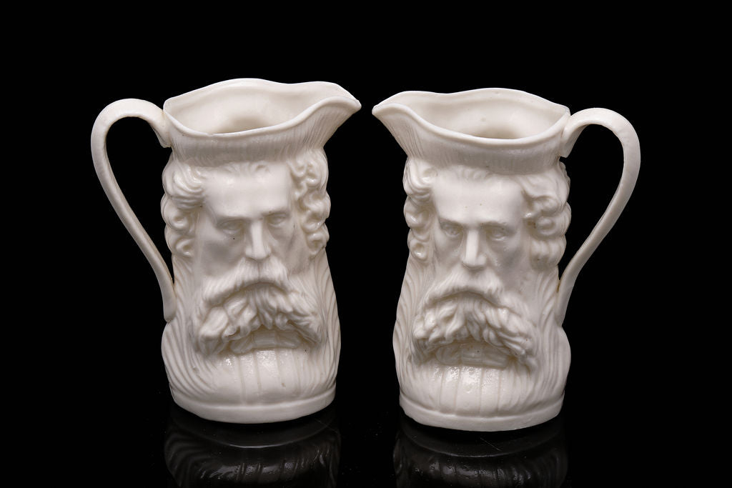 C1900 Pair of Two Faced Victorian Jugs.