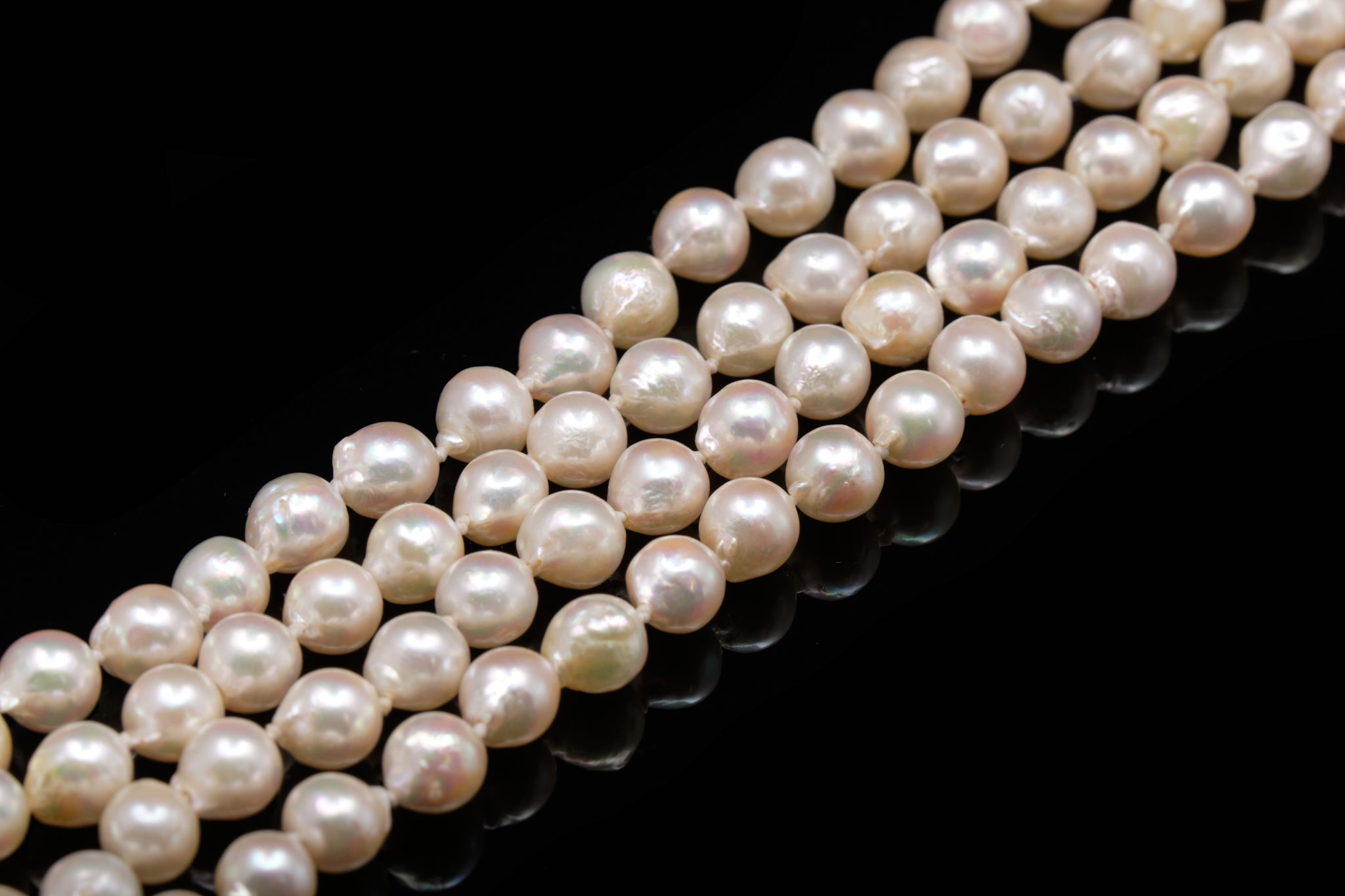 Long String Of Cultured Pearls.