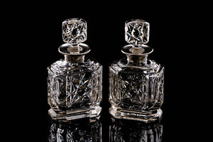 Edwardian Sterling Silver Collared Perfume Bottles.