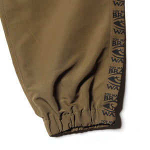 SIDE LOGO WIND PANTS - KHAKI