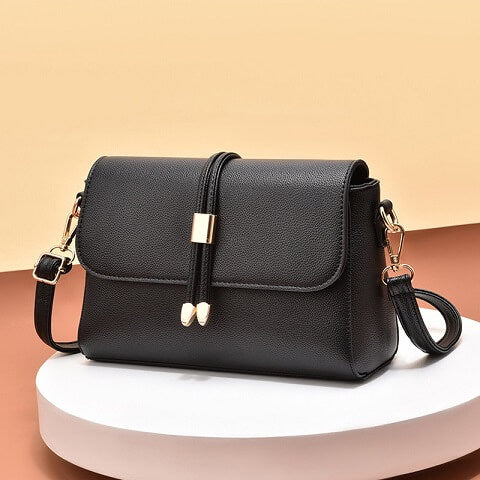 Evelin Barron handbag can be transformed from a crossbody bag to a clutch and evening bag to suit your ensembles.