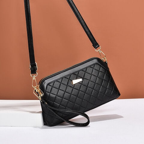 Ariel Garrison handbag can be transformed from a crossbody bag to a wristlet, clutch and evening bag to suit your ensembles.