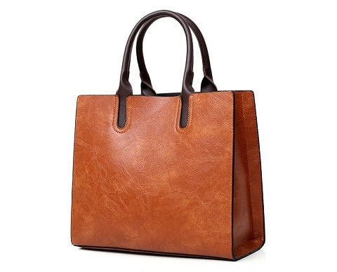 Zara Henderson handbag can be transformed from a crossbody bag to a top-handle bag to suit your ensembles.