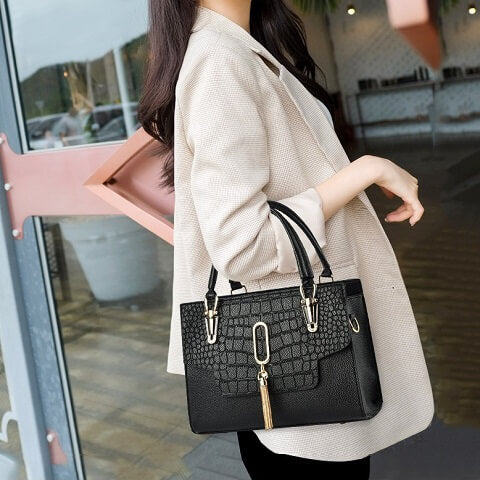 Khloe Cooper handbag can be transformed from a crossbody bag to a top-handle bag to suit your ensembles.