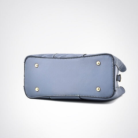 Elliana Reyes handbag can be transformed from a crossbody bag to a top-handle bag to suit your ensembles.