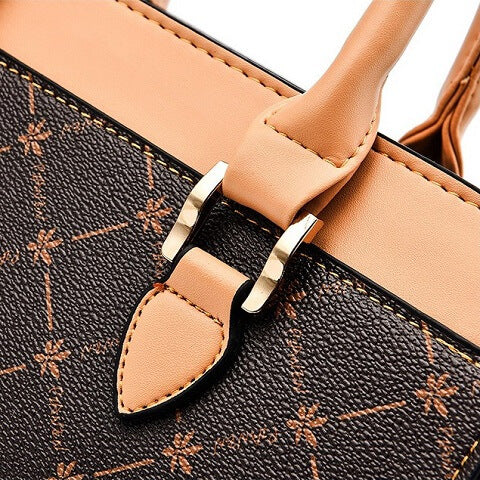 Sylvia Hood handbag can be transformed from a crossbody bag to a top-handle bag to suit your ensembles.
