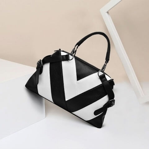 Kylan Franklin handbag can be transformed from a crossbody bag to a top-handle bag to suit your ensembles.