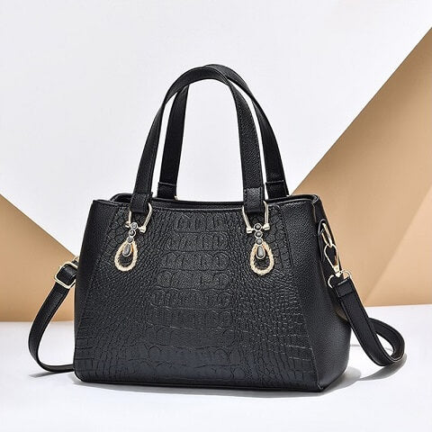 Meghan Larsen handbag can be transformed from a crossbody bag to a top-handle bag to suit your ensembles.