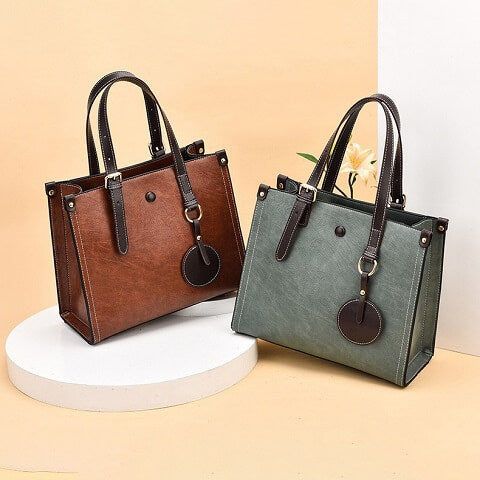 Camille Gibbs handbag can be transformed from a crossbody bag to a top-handle bag to suit your ensembles.