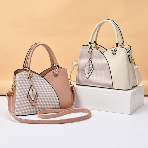Lauryn Randall handbag can be transformed from a crossbody bag to a top-handle bag to suit your ensembles.