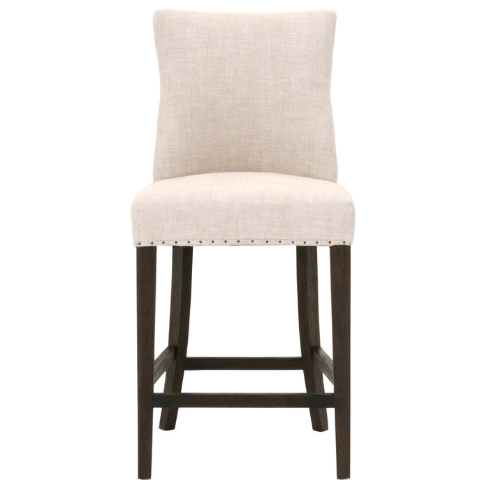 "Lourdes Counter Stool in Bisque French Linen, Rustic Java Oak | Black Nail Tacks Transitional style counter stool featuring Rustic Java finish and Black nail tack detail. Featuring Solid Oak Frame, 100% French Linen Upholstery W:19.5"" D:23"" H:40.5"" Essentials Collection"