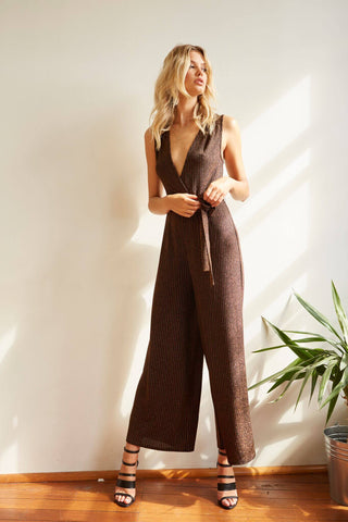 Harmony Jumpsuit is a super cute open back midi jumpsuit with cutout detailing on the hem. Pair it back with a cute pair of wedges!