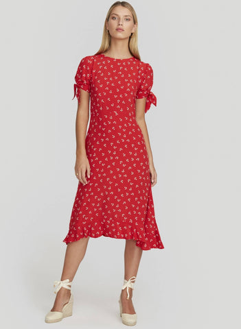 THIS IS A HIGH NECK MIDI DRESS WITH TIE SLEEVES AND CIRCLE SKIRT WITH FRILL ON HEMLINE. INVISIBLE ZIPPER TO THE BACK.