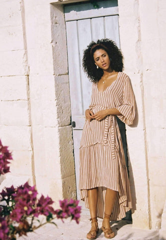Matilda Peasant Dress - Almeria Stripe Pink  $ 229.00 CAD  Style# FF1235  DESCRIPTION  THIS IS A MIDI DRESS WITH A V NECKLINE, ELASTIC SLEEVES, UNEVEN HEMLINE, OPTIONAL WAISTLINE BELT.