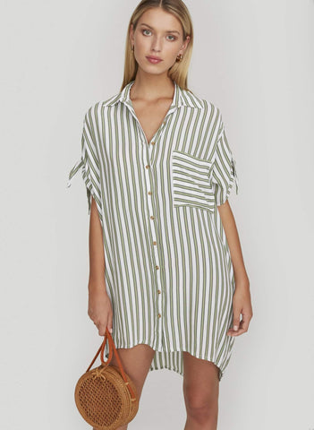OVERSIZED SHIRT DRESS WITH HIGH LOW HEM. BUTTON FRONT DETAILING WITH LEFT CHEST POCKET. RELAXED SLEEVES WITH TIE DETAILING.