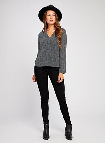 Antonia Blue Nights Microdot Navy Top  $ 95.00 CAD  SKU# GF190-2399  Details: Long sleeve blouse V-neck with draping in back. Model is wearing a size S Fabrication: 100% Polyester