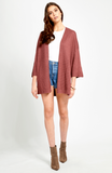 Oversized cardigan with side pockets. Model is wearing a size S FABRICATION:  58% Linen 42% Rayon
