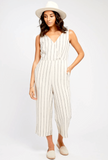 Arthur Jumpsuit  $ 129.00 CAD  SKU# GF192-7117  DETAILS:  A Gentle Fawn best seller!  Easy to wear jumpsuit with side pockets Back tie detail Zipper enclosure at side Model is wearing a size 4  FABRICATION:  55% Linen 45% Rayon 100% Polyester (Lining) Care: Hand wash cold + Hang to dry