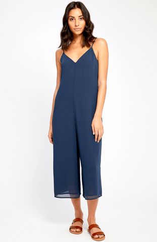 This jumpsuit is sure to look cute and casual — not to mention will feel super comfortable, thanks to its roomy shape — when worn with flat sandals or sneakers, and a denim jacket layered overtop. Then, dress it up with some strappy heels and sun-kissed skin for an evening out.  A must have for that sunny vacay! The loose, relaxed cut is balanced by the flowing fabric.