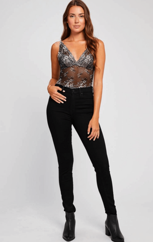 Valentine Petal Black Bodysuit  $ 78.00 CAD  Style# GF190-9165  DETAILS:  A Gentle Fawn best seller!  Black lace bodysuit with adjustable straps.  All underwear & bodysuits are final sale. No returns or exchanges.  Model is wearing a size small.  62% Nylon, 26% Rayon, 12% Spandex
