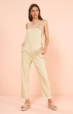Thin adjustable straps with eyelet tie through  Straight neckline Exposed profile stitching Side button entry Twin pockets Frayed leg hole hem Full length  Relaxed fit