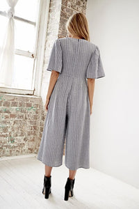 A jaunty knot secures the dramatically plunging neckline of this breezy, wide-leg jumpsuit cut from a lightweight, striped cotton.  Perfect for date night, the SOMEDAY'S LOVIN Stepping Out Jumpsuit is easy to dress up or down for any occasion.