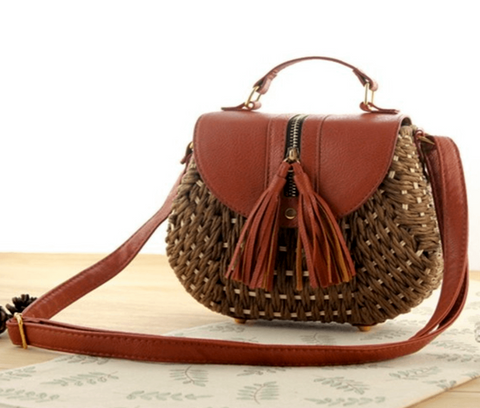 Straw Knitted Bag  $ 40.00 CAD  SKU# 14694901  DETAILS:  This beautiful Bohemian Tassel Straw bag is great for beach, everyday wear and casual function. Interior Compartment Interior Slot Pocket Exterior Flap Pocket Tassels Saddle shape Straw material Hasp closure Polyester lined material