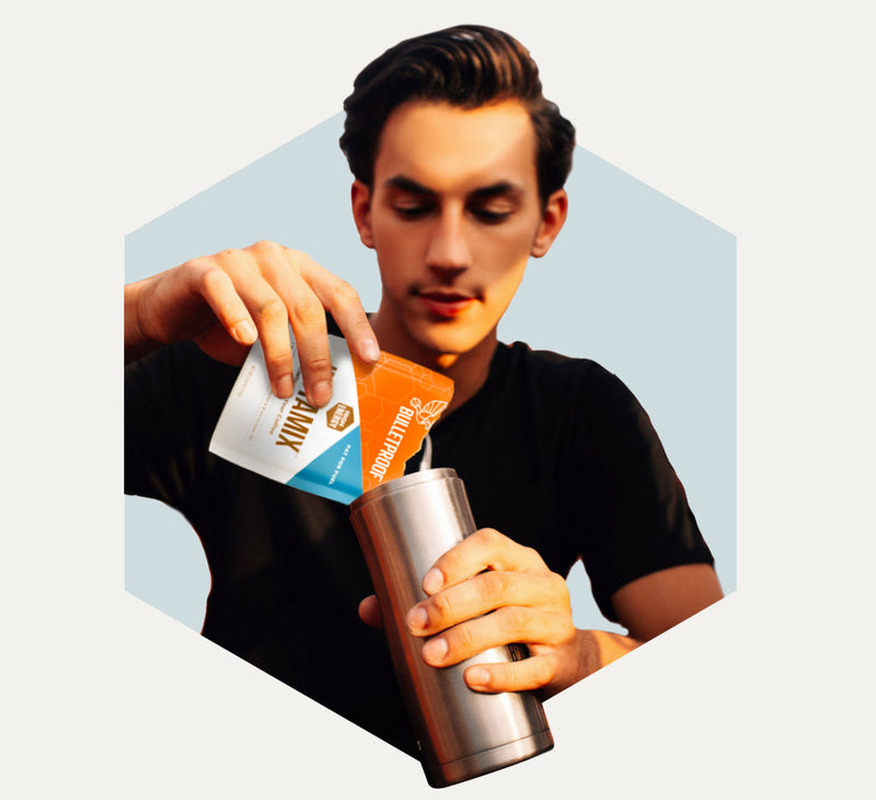 Man pouring Bulletproof Coffee InstaMix into bottle