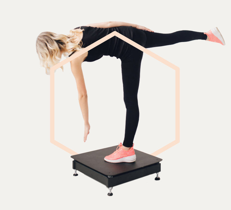 Woman balancing on Bulletproof Whole Body Vibration Plate