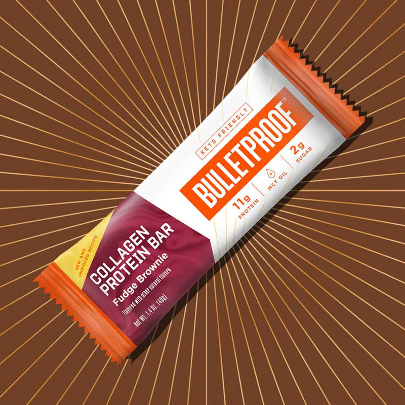Bulletproof Fudge Brownie Collagen Protein bar with orange rays