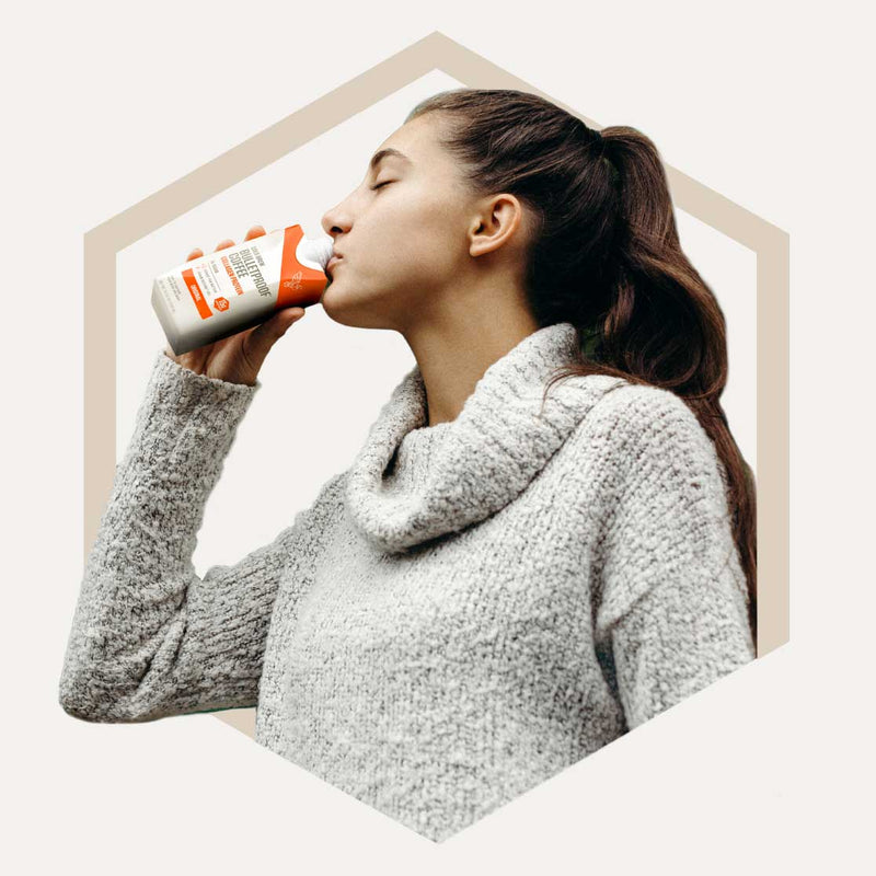Woman drinking Bulletproof Coffee Cold Brew with Collagen Protein