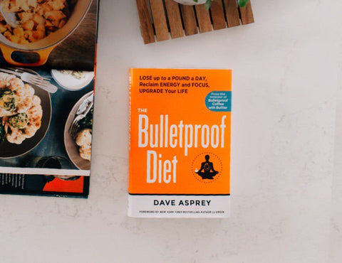 The Bulletproof Diet book sitting on a table