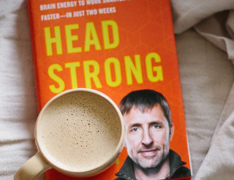 Cup of Bulletproof Coffee resting on copy of Dave Asprey's 'Headstrong'