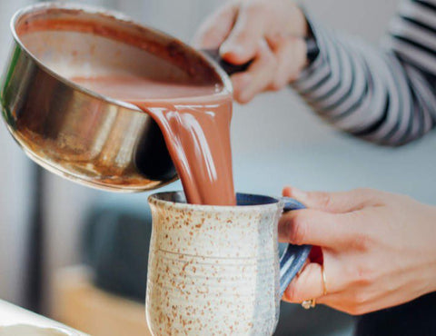 Bulletproof Hot Cocoa being poured into cup