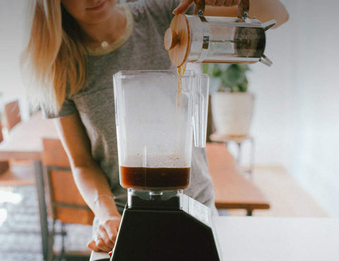 Bulletproof Coffee being poured into blender