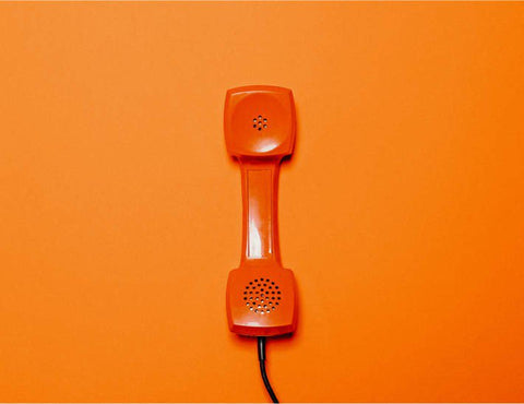 Orange telephone handset