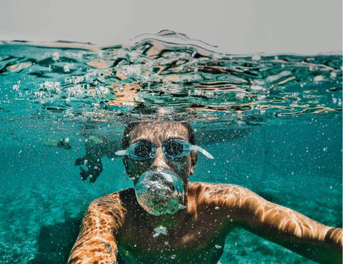 Person swimming under the water