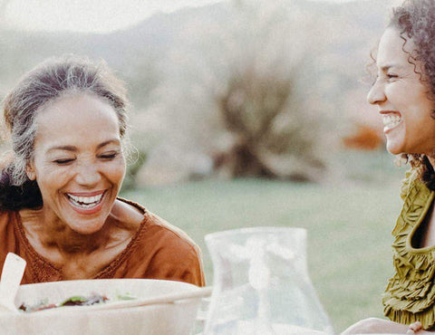 Women laughing during meal